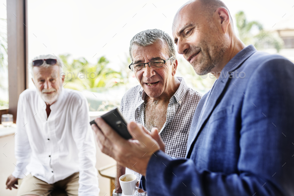 Group of senior men talking - Stock Photo - Images