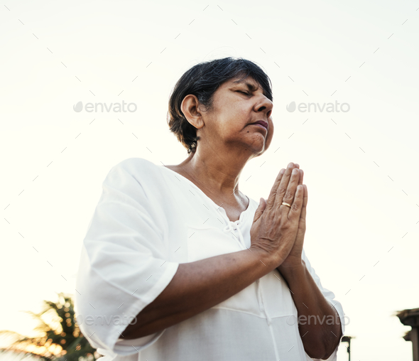 Senior adult practicing yoga outdoors - Stock Photo - Images