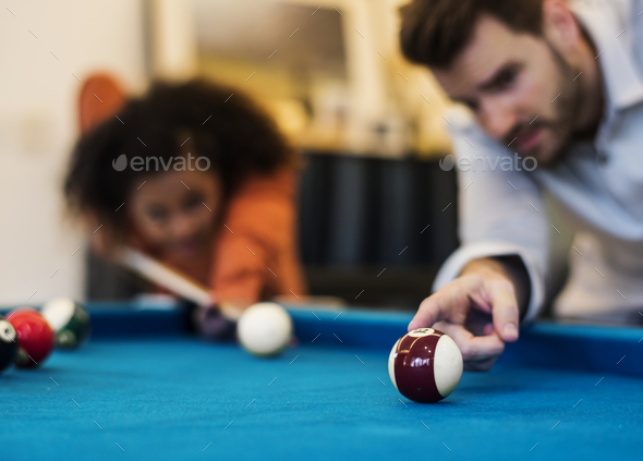 Happy friends playig pool together - Stock Photo - Images