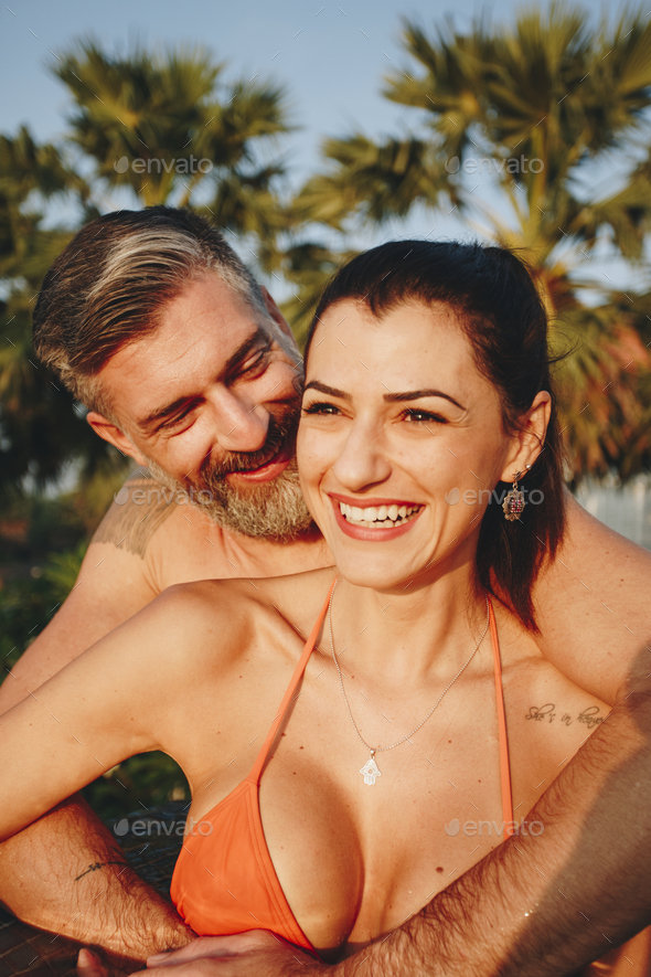 Honeymooners in a swimming pool at a resort - Stock Photo - Images