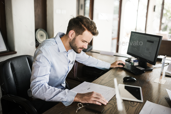 Man working in an office - Stock Photo - Images