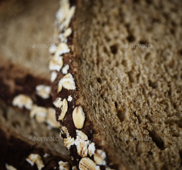 Close up of a slice of brown bread - Stock Photo - Images