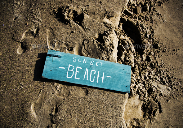 Wooden sign on the sand - Stock Photo - Images