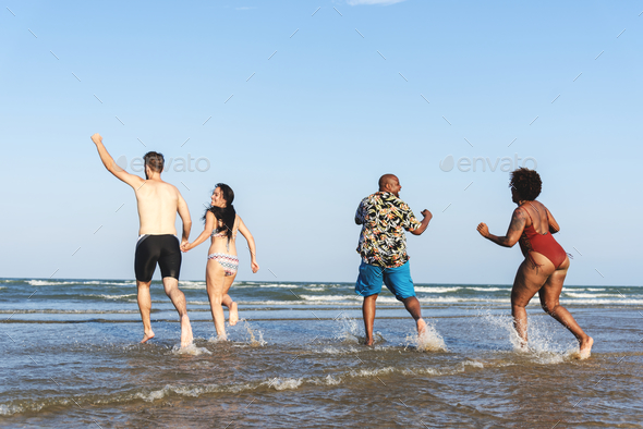 Diverse friends having fun at the beach - Stock Photo - Images