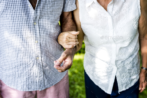 Senior couple holding each other - Stock Photo - Images