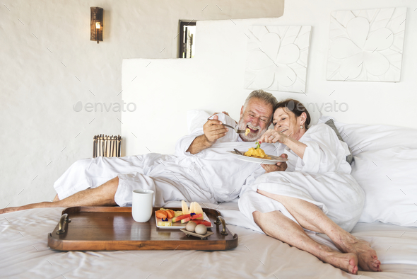 Mature couple in a luxurious hotel room - Stock Photo - Images