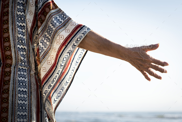 Senior woman reaching out her hand - Stock Photo - Images