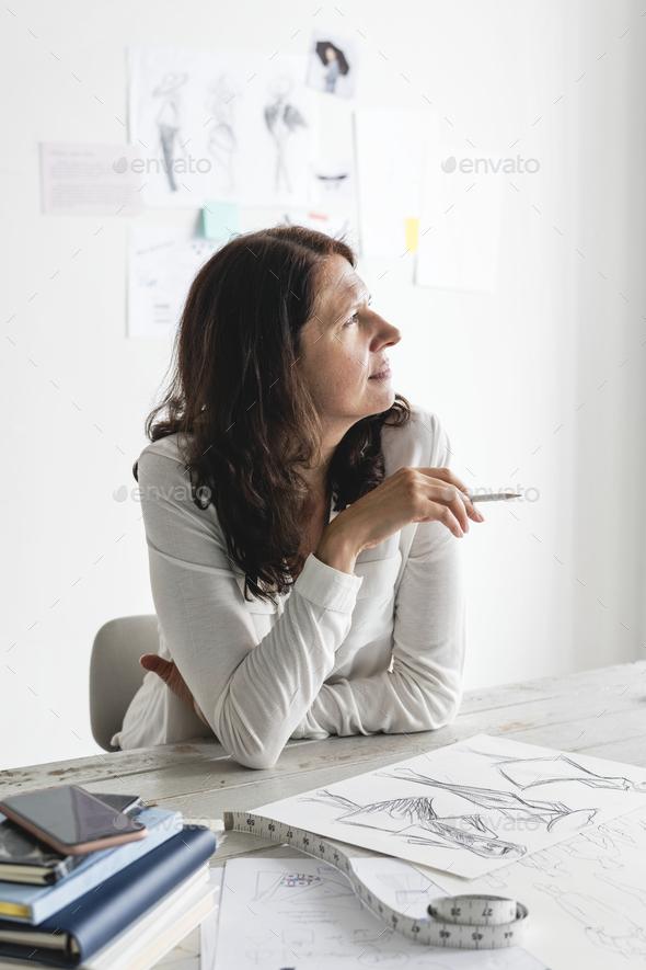 Caucasian designer creating new design - Stock Photo - Images