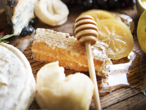 Close up of honey comb on a cheese board - Stock Photo - Images