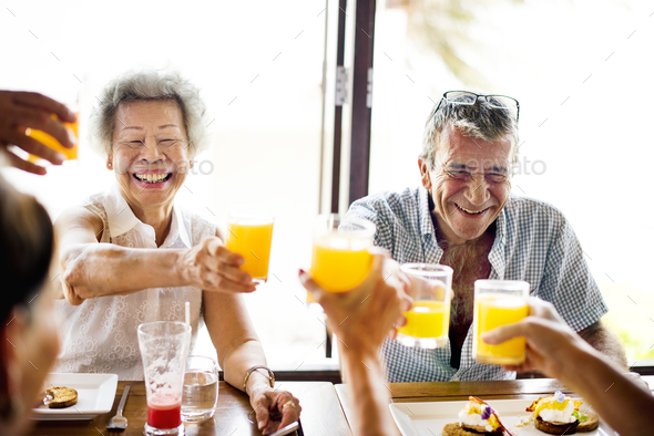 Senior adults eating breakfast at hotel - Stock Photo - Images