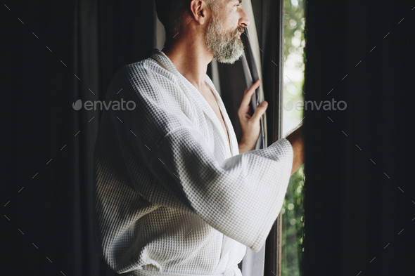 Cheerful man in a bathrobe - Stock Photo - Images