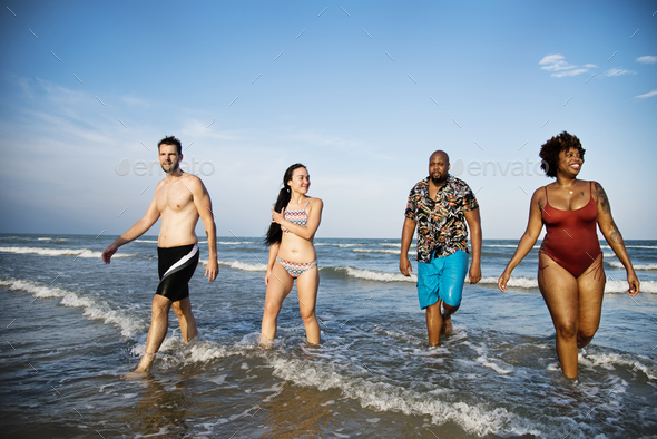 Friends having fun on the beach - Stock Photo - Images