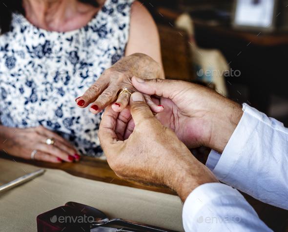 Romantic senior couple getting engaged - Stock Photo - Images