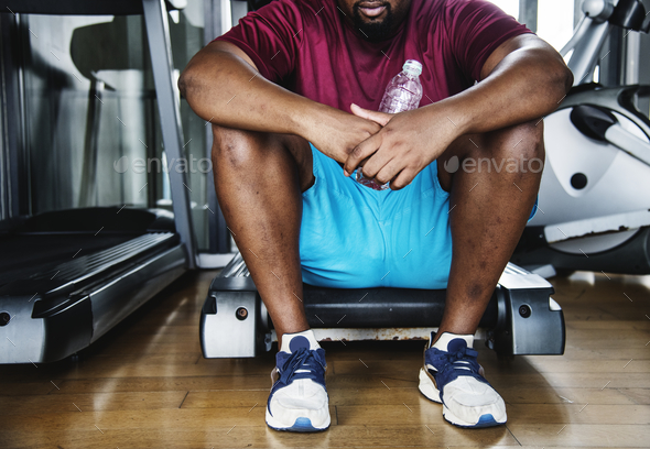 Man taking a break from a workout - Stock Photo - Images