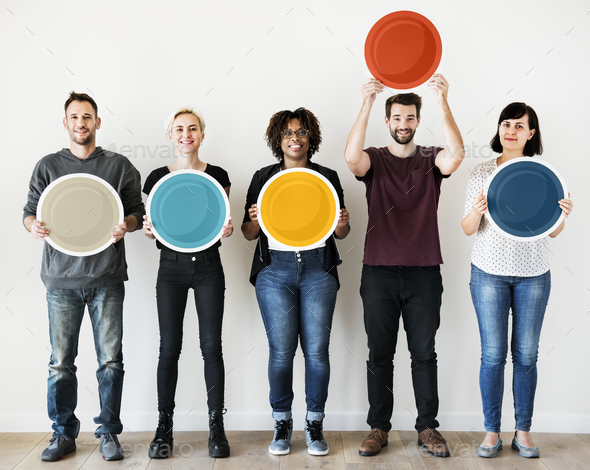 Diverse people holding blank round board - Stock Photo - Images