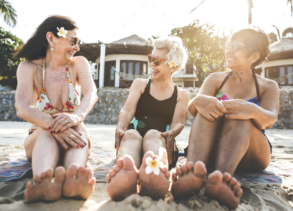 Senior women friends on the beach - Stock Photo - Images