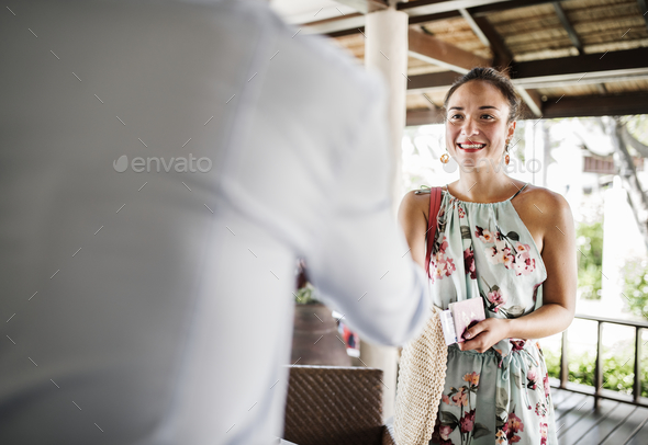 Guests checking in to a hotel - Stock Photo - Images