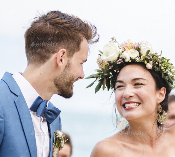 Cheerful newlyweds at beach wedding ceremony - Stock Photo - Images