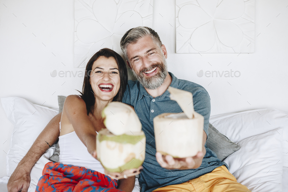 Couple relaxing on the bed - Stock Photo - Images