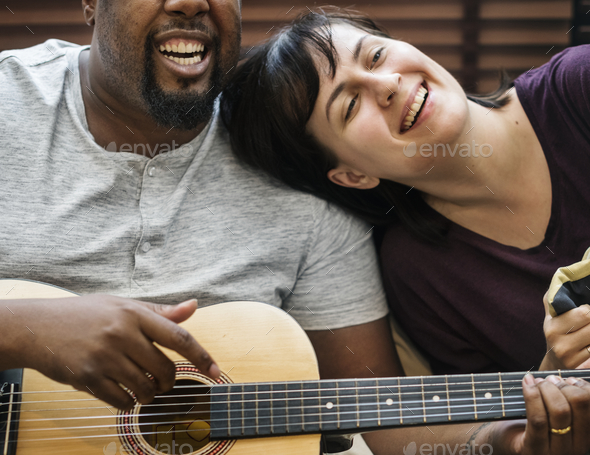 Couple playing and singing together - Stock Photo - Images