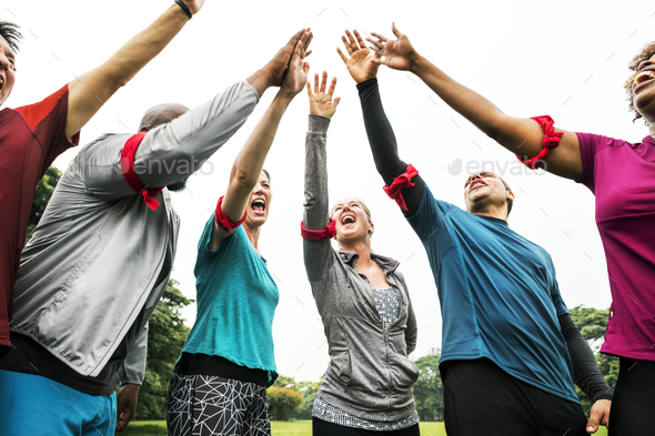 Diverse team stacking their hands - Stock Photo - Images