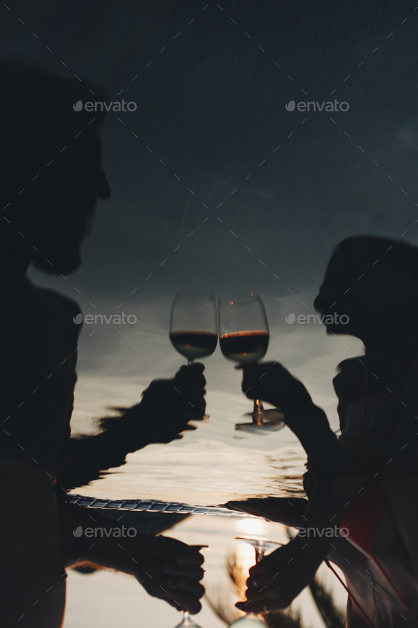 Couple drinking wine in a pool - Stock Photo - Images
