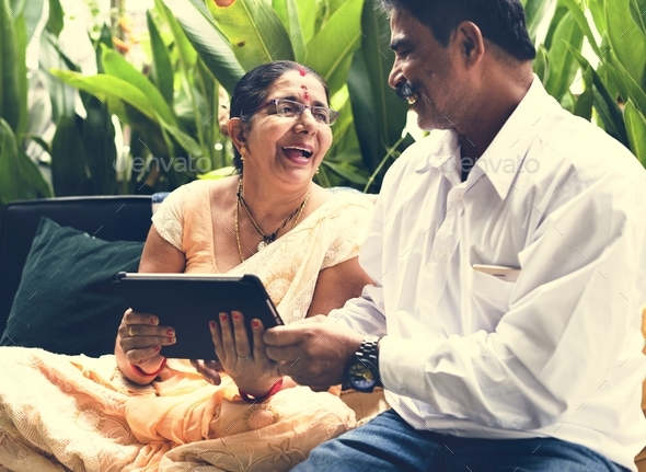A happy Indian couple spending time together - Stock Photo - Images