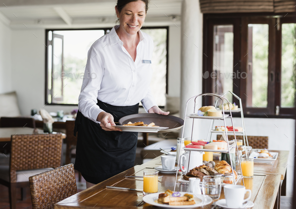 Hotel waitress serving food - Stock Photo - Images