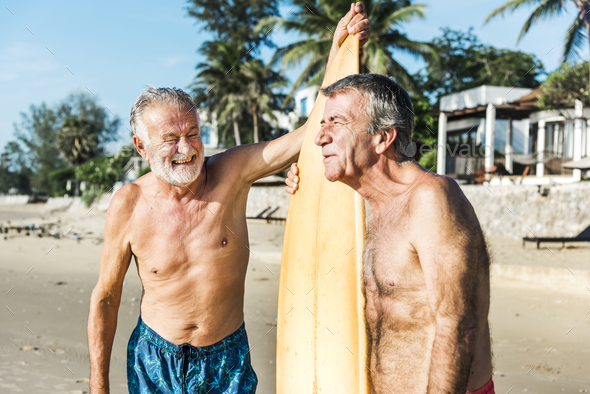 Surfers at a nice beach - Stock Photo - Images