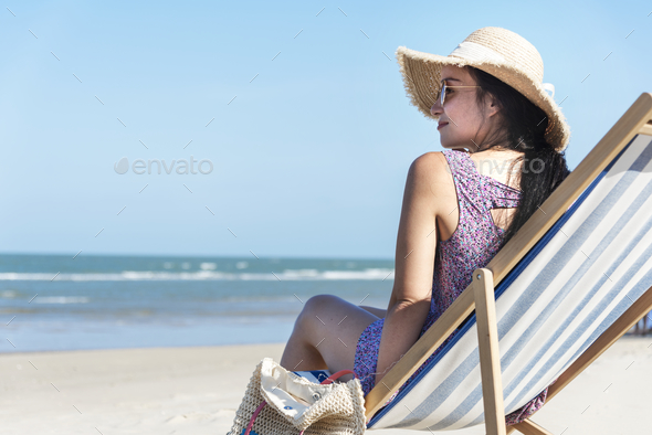 Asian woman relaxing at the beach - Stock Photo - Images