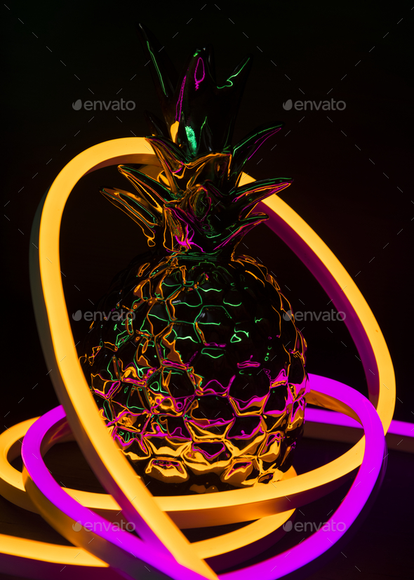Pineapple covered in neon lights - Stock Photo - Images
