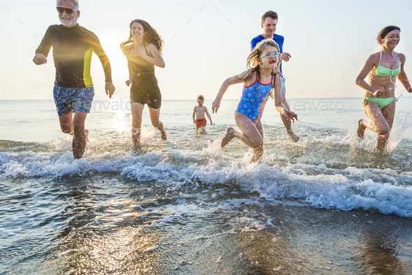 Family playing at the beach - Stock Photo - Images