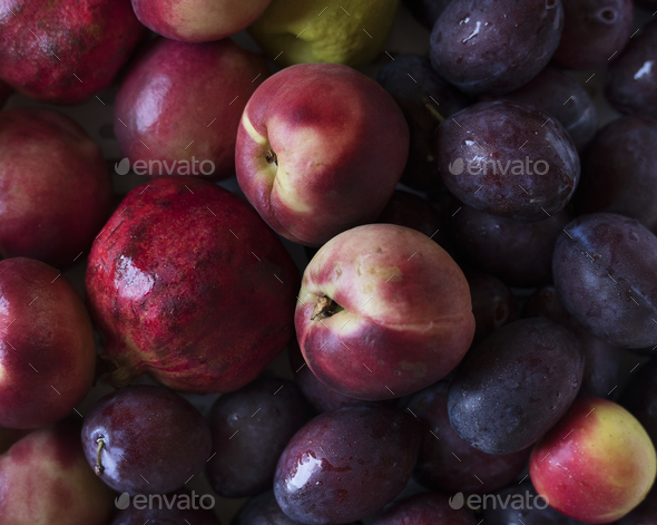 Closeup of plums and other fruits - Stock Photo - Images