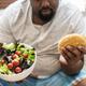 Man eating a big hamburger - PhotoDune Item for Sale