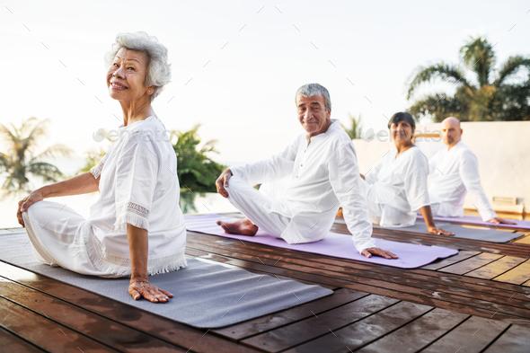 Group of seniors practicing yoga - Stock Photo - Images