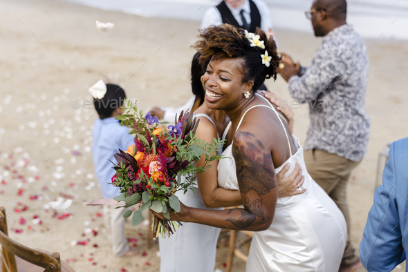 African American xouple getting married at the beach - Stock Photo - Images