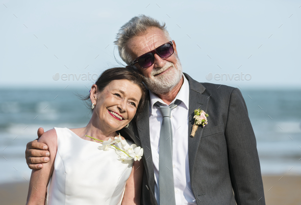 Senior couple getting married at the beach - Stock Photo - Images