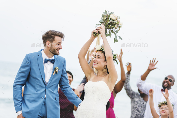 Bride throwing flower bouquet to guests - Stock Photo - Images