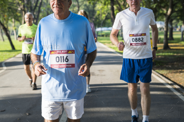 Senior athletes running in the park - Stock Photo - Images