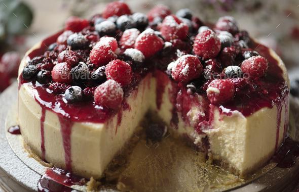 Fresh berry cheescake food photography recipe idea - Stock Photo - Images