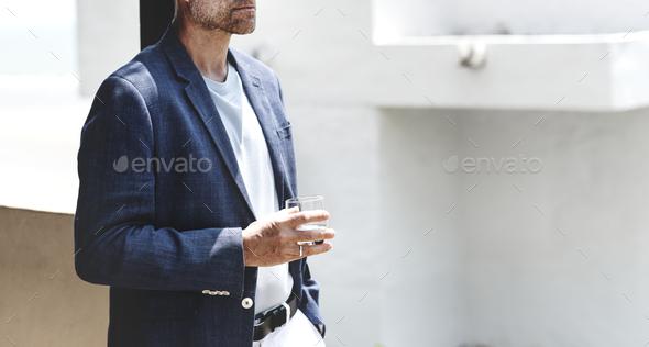 Senior man having an alcoholic drink - Stock Photo - Images