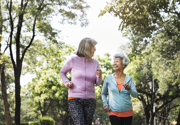 Senior friends exercising outdoors - Stock Photo - Images