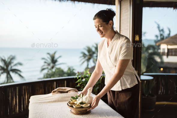 Masseuse preparing massage table - Stock Photo - Images