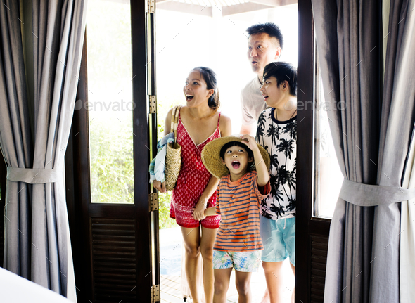 Asian family on vacation - Stock Photo - Images
