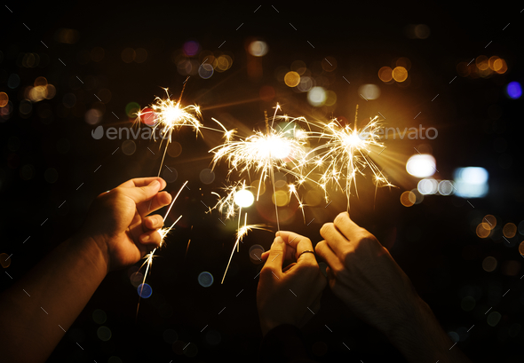 Celebrating with sparklers in the night - Stock Photo - Images