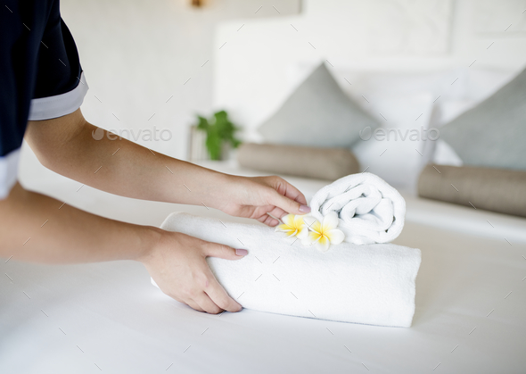 Housekeeper cleaning a hotel room - Stock Photo - Images