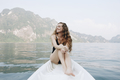 Woman relaxing on a canoe at a lake - PhotoDune Item for Sale