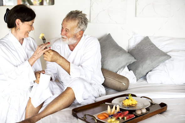 A senior couple enjoying room service - Stock Photo - Images