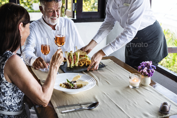 Mature couple having lunch at a restaurant - Stock Photo - Images