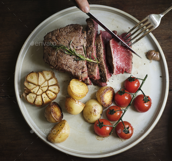 Close up of a cutting a fillet steak food photography recipe idea - Stock Photo - Images